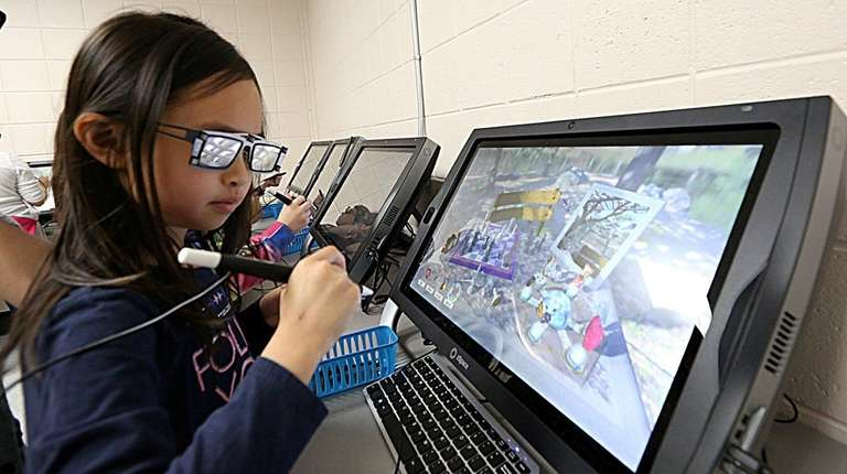 Second-grader Sophie Ngai explores zSpace on May 19,