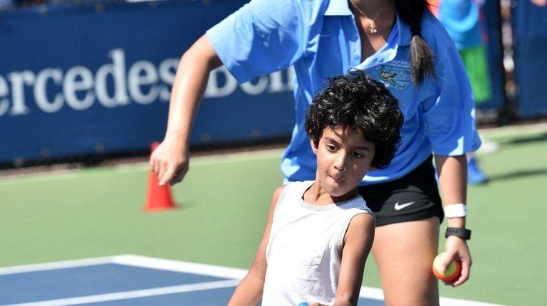 Arav Pathak, 5, of Manhattan starts his return