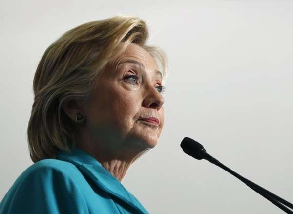Democratic presidential candidate Hillary Clinton pauses as she