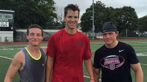 Eli Manning with two of his summer receiving