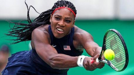 Serena Williams reaches for a return against Daria