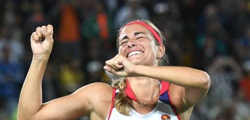Monica Puig of Puerto Rico celebrates defeating Angelique