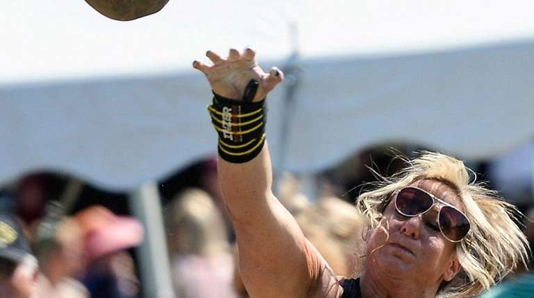 Shawna Mendelson, of Bohemia, competes in the stone