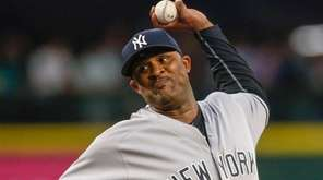 CC Sabathia pitches against the Mariners in the
