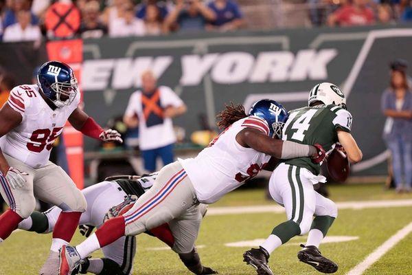 Damon Harrison of the Giants takes Jets quarterback