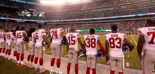 Giants players line up for the National Anthem