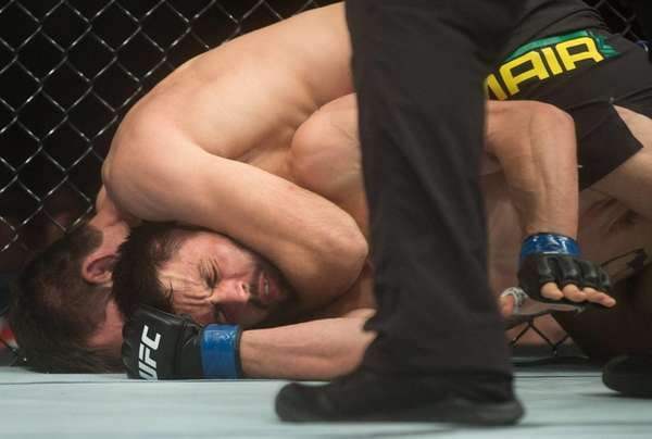 Demian Maia, top, of Brazil, and Carlos Condit,