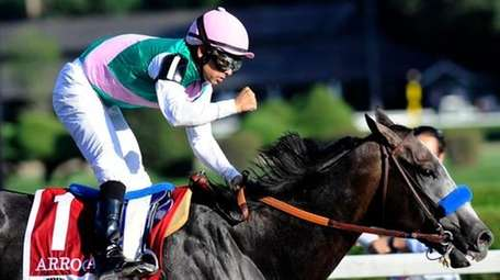 Jockey Mike Smith celebrates aboard Arrogate after winning