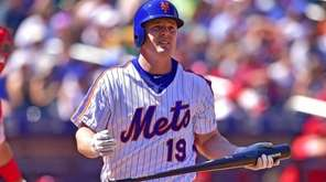 Jay Bruce reacts after striking out during the