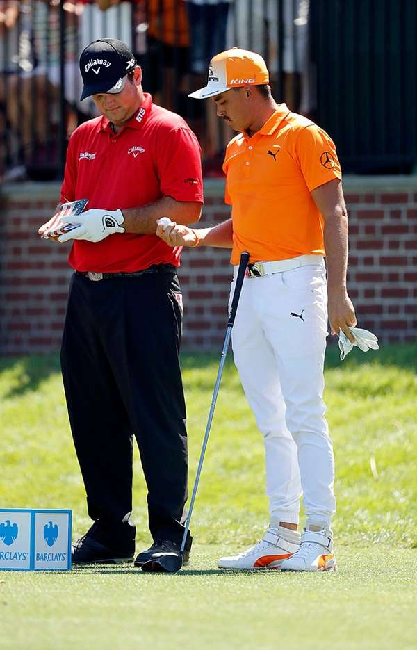 Patrick Reed (l) and Rickie Fowlerinspect each others