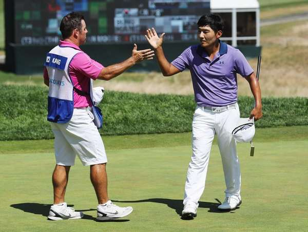 Sung Kang of South Korea celebrates with his