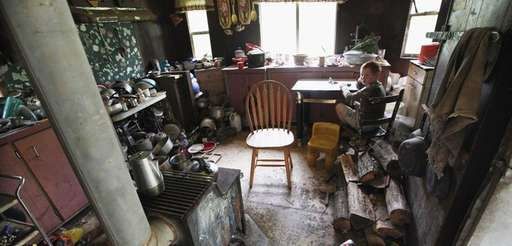 Johnny Noble, 9, sits in his Uncle Mose's