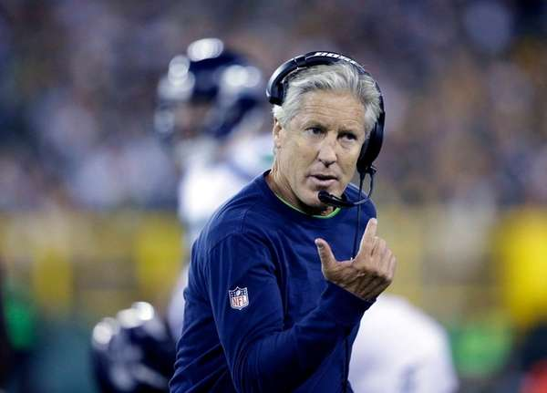 Seattle Seahawks head coach Pete Carroll argues a