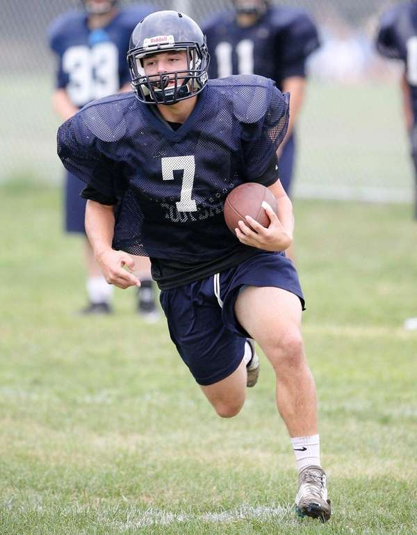 James Cadigan runs the ball during the Smithtown
