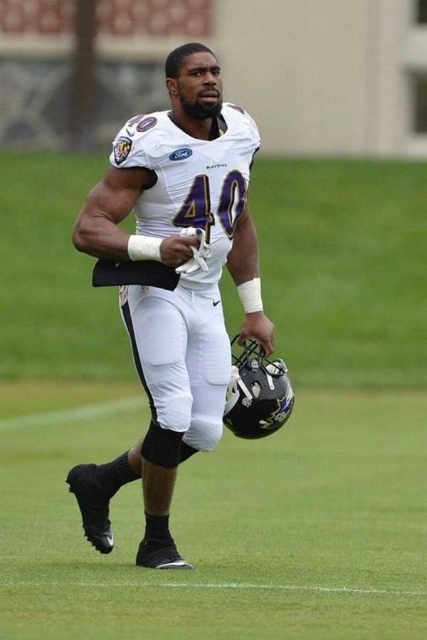 Baltimore Ravens linebacker Victor Ochi takes part in