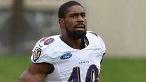 Baltimore Ravens linebacker Victor Ochi takes part in