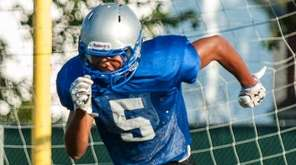 Copiague's Jabbar Morris does a drill during training