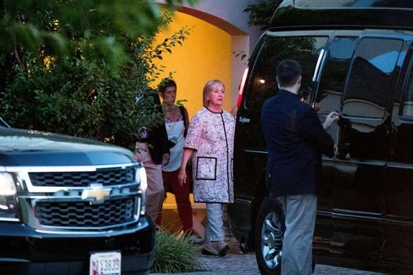 Democratic presidential candidate Hillary Clinton, center, leaves a