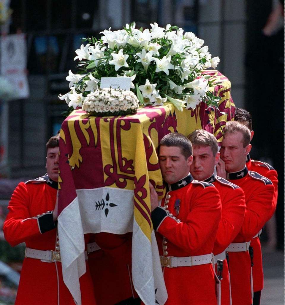 Princess Diana's coffin is carried out of Westminster