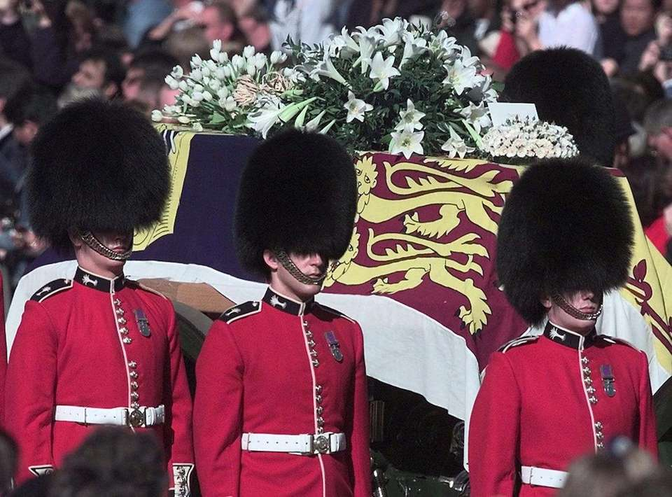 The coffin carrying Diana, Princess of Wales, passes
