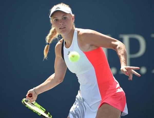 Caroline Wozniacki returns to Taylor Townsend during the