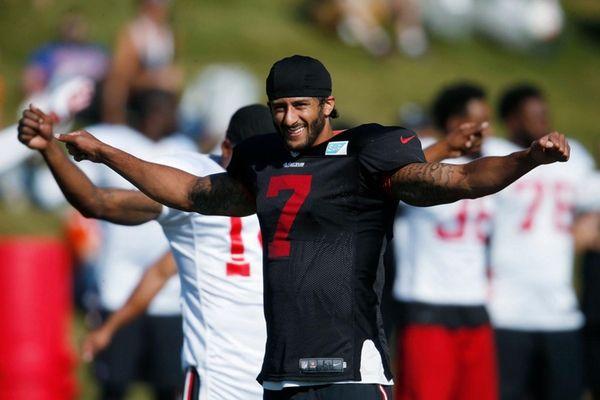 San Francisco 49ers quarterback Colin Kaepernick stretches before