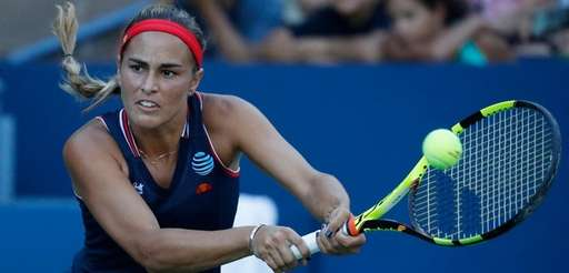 Monica Puig of Puerto Rico hits a return