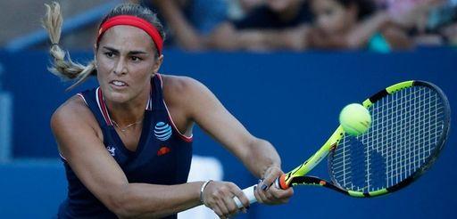 Monica Puig of Puerto Rico hits a return