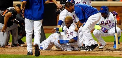 Jose Reyes of the Mets is helped up
