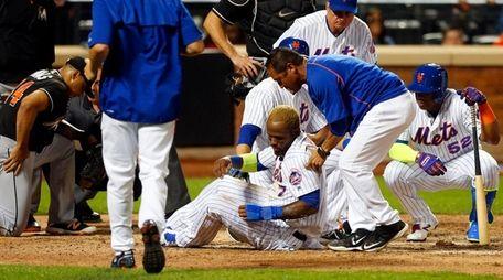 Jose Reyes of the Mets is helped up