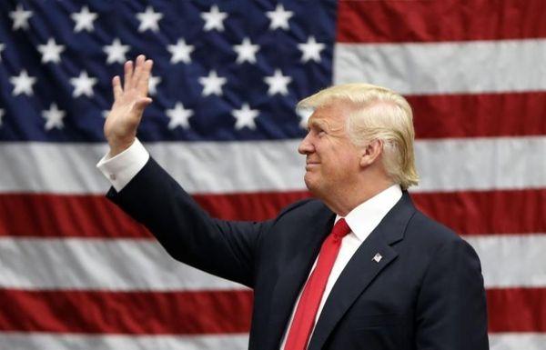 Republican presidential candidate Donald Trump arrives to speak