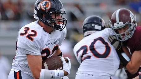 Manhasset's Will Theodoropoulos races upfield during the first