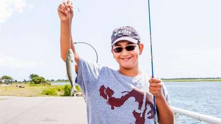 Steven Christophorou, 12, of West Hempstead catches his