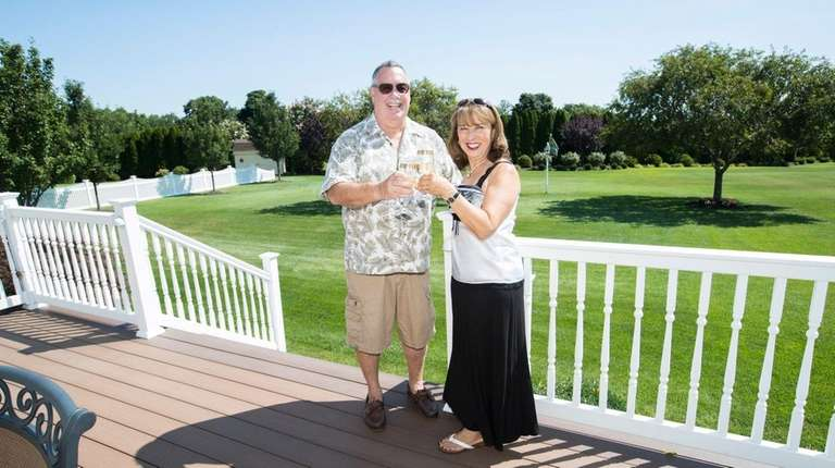 Ken and Gloria Beers offer a toast on