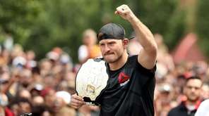 UFC heavyweight champion Stipe Miocic looks on during