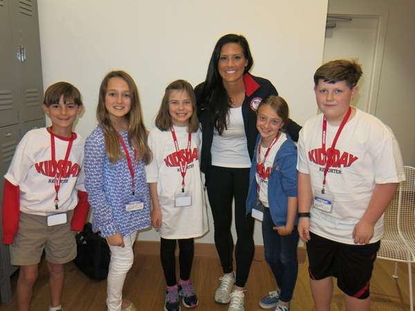 Soccer star Ali Krieger with Kidsday reporters from