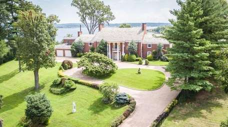 This Kings Point Colonial has nine bedrooms and