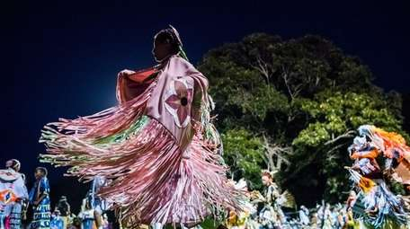 Tribe members dance in the Grand Entry at