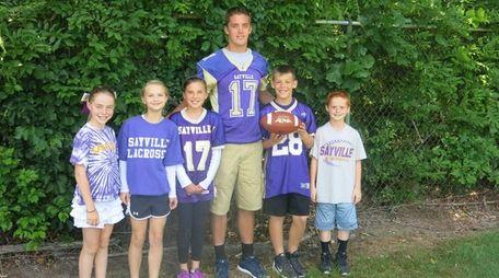 Sayville High School quarterback Jack Coan with Kidsday