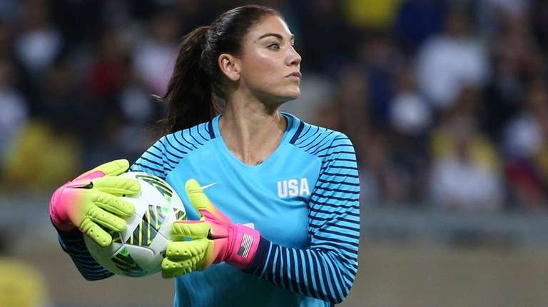 Hope Solo takes the ball during a women's