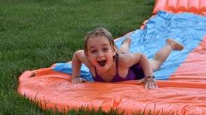 Olivia on slip n slide