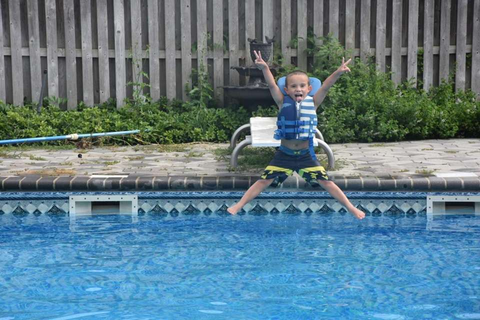 Junior jumping into the pool
