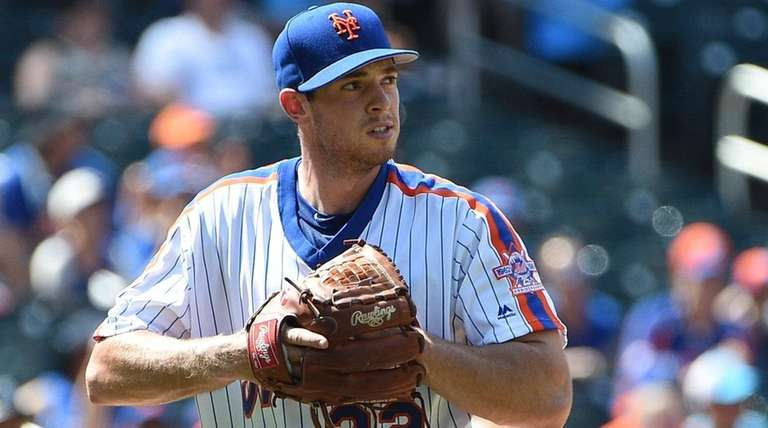 New York Mets starting pitcher Steven Matz walks