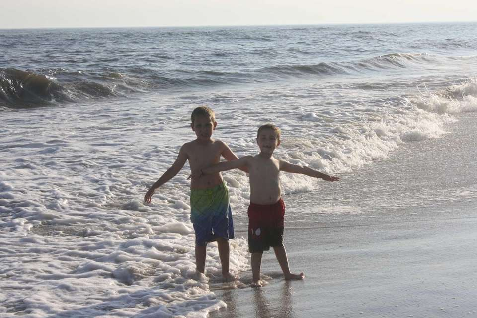 2 brothers standing in the surf at Robert