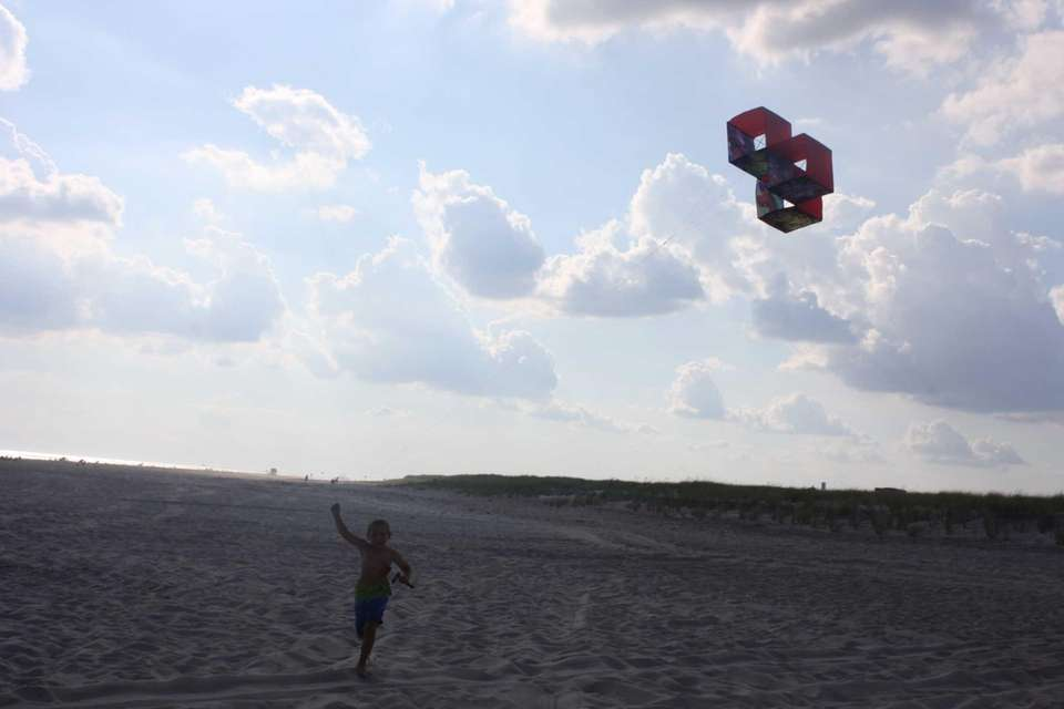 Flying a kite during a summer night at