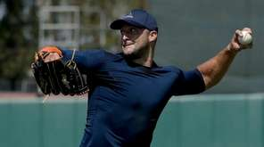 Former NFL quarterback Tim Tebow throws a ball