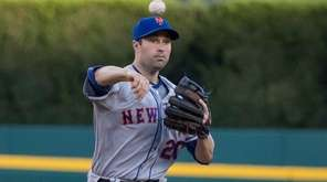Neil Walker turns a double play against the