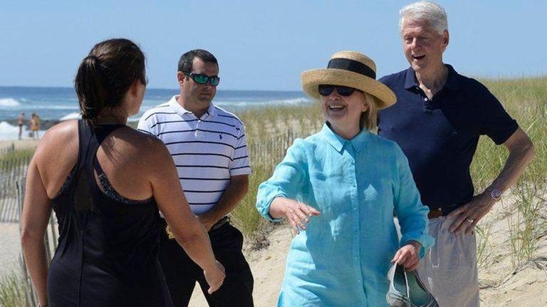 Hillary and Bill Clinton walk along Georgica Beach