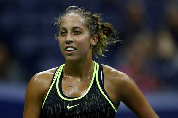 Madison Keys reacts in the first set against