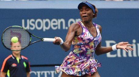 Venus Williams returns to the Ukaine's Kateryna Kozlova